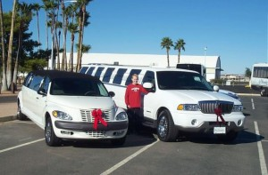 Lexani Limousine's Billy Jinks with two of his limos.