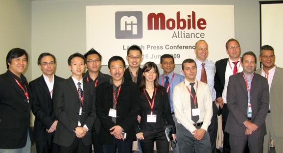 Founding members of the Mobile Alliance, with various representatives from key partners.
