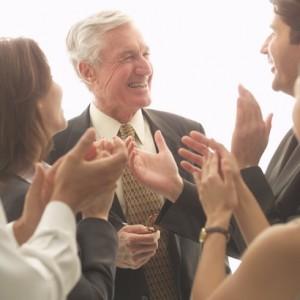Colleagues Applauding Senior Businessman
